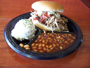 HIckory smoked, pulled pork sandwich plate wit...