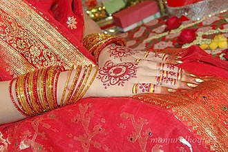 Bengali Muslim wedding - A bride dressed in red sari