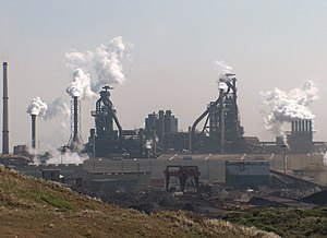 Heavy industry - Integrated steel mill in the Netherlands. The two massive towers are blast furnaces.
