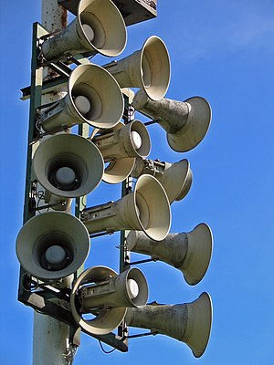 Public address system - Horn loudspeakers are often used to broadcast sound in outdoor locations