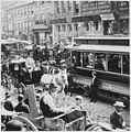 Horse-drawn wagons and carriages, an electric trolley car, and pedestrians congest a cobblestone Philadelphia street in - NARA - 513362.jpg