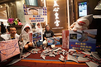 Maxim's Caterers - Anti Shark finning protest at Maxim's Palace restaurant, Hong Kong 10 June 2017.