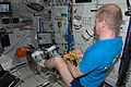 ISS-21 Frank De Winne performs activation and checkout steps in the Columbus lab.jpg