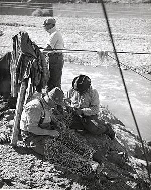 Salmon cannery - Repairing salmon nets, ca. 1950