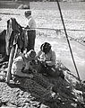 Indian salmon fishermen repairing their nets.jpg