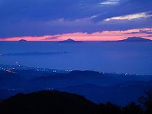 Isole Eolie al tramonto viste dal monte Dinnammare, Peloritani