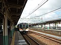JRE E129 at Kamo Station.jpg