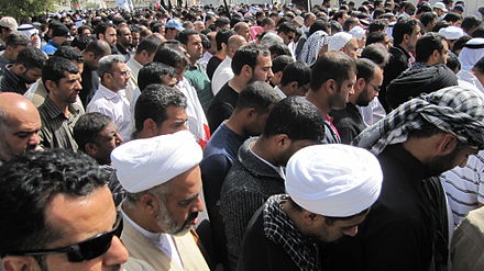 Bahrainis observing public prayers in Manama
