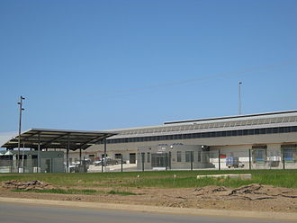 King Shaka International Airport - A view of the cargo terminal from the main access road leading to it, showing bays for goods vehicles and the reception area.