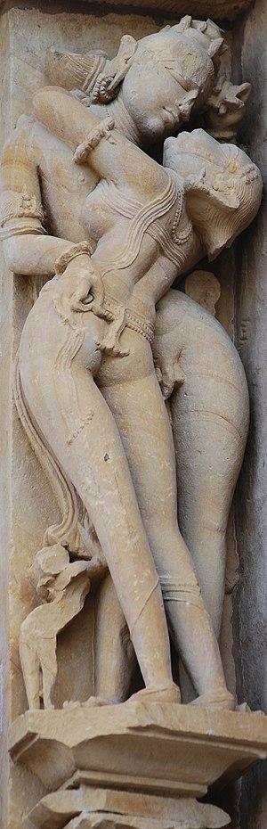 Chitragupta temple, Khajuraho - Image: Khajuraho couple kissing