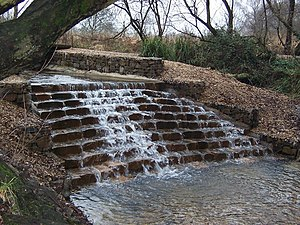 English: Kinson Common Water fall. The man mad...