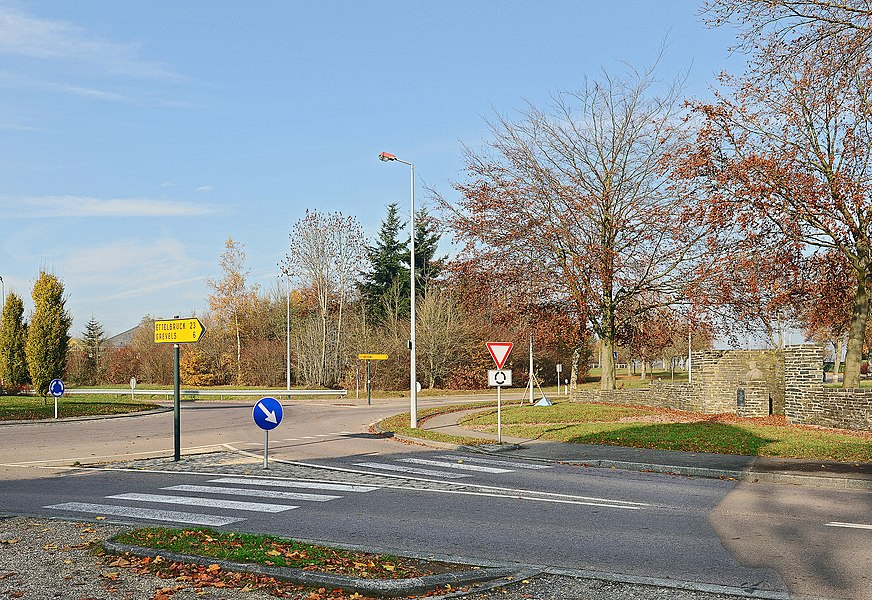 Cross-roads at Koetschette, Luxembourg. At right: Monument commemorating Etienne Schmit (1886-1937), former minister of Luxembourg.