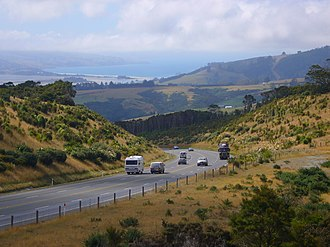 Limited-access road - The Dunedin Northern Motorway, a typical non-freeway-type motorway in New Zealand