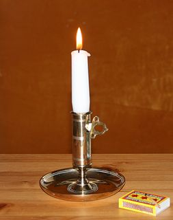 Candle solid block of wax with embedded wick