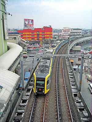 Manila Light Rail Transit System - An LRT-1 train approaching EDSA station
