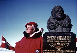 Laurence Gould posing next to a bust of American polar explorer Richard Evelyn Byrd. 1977.jpg