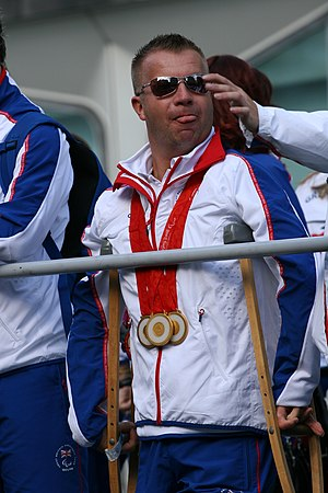 2008 Summer Paralympics medal table - British para-dressage rider Lee Pearson wearing his medals from the 2008 Paralympics