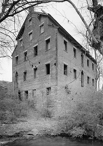 Lenoir Cotton Mill - The Lenoir Cotton Mill, rising above Town Creek