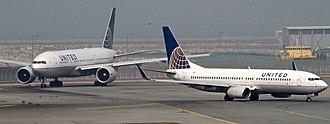 Hong Kong International Airport - United Airlines Boeing 777-200 and Boeing 737-800 taxiing.
