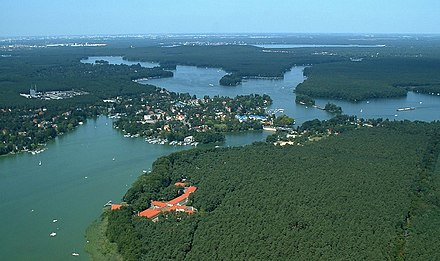 The outskirts of Berlin are covered with woodlands and numerous lakes. Luftbild bln-schmoeckwitz.jpg