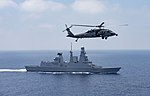 MH-60S Seahawk from HSC-9 flies past the French destroyer Chevalier Paul (D621) in the Mediterranean Sea on 15 July 2017.JPG