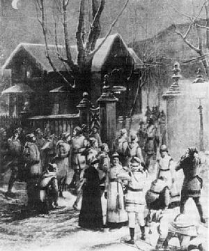 Montreal Snow Shoe Club - Members of the MSSC at their traditional meeting place, the McGill gatehouse on Sherbrooke Street, before a moonlight 'tramp' in 1889