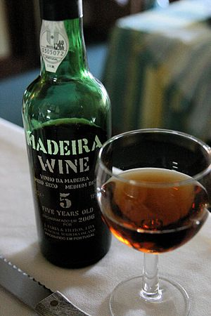 Bottle and glass of 5 year old Madeira wine. T...