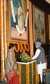 Manmohan Singh, paying floral tributes at the portrait of the former Prime Minister, late Smt. Indira Gandhi on her 92nd birth anniversary, at Central Hall, Parliament House, in New Delhi on November 19, 2009.jpg