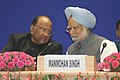 Manmohan Singh in conversation with the Union Minister for Agriculture, Consumers Affairs, Food & Public Distribution, Shri Sharad Pawar at the International Rice Congress-2006, in New Delhi on October 09, 2006.jpg