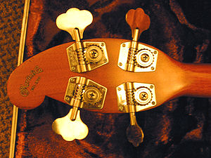 Machine head - Martin EB18 bass guitar headstock, showing Martin open type machine heads.