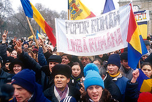 "Unification of Romania and Moldova - Opposition demonstration in Chișinău in January 2002. The text on the inscription reads ""Romanian people–Romanian language""."
