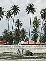 Men burn and coat a boat on the shores of Zanzibar.jpg