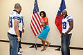 Michelle Obama with Dallas Cowboys football players.jpg