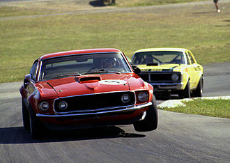 Group C (Australia) - The Ford Mustang Boss 302 Group C Improved Production Touring Car of Allan Moffat leading the Super Falcon of Pete Geoghegan at Lakeside in 1972