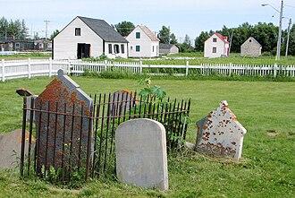 Moose Factory - Centennial Park - foreground: historic cemetery; background (from left to right): blacksmith shop, McLeod House, Sackabuckiskum House, Powder magazine.