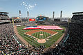 More than 100 U.S. Navy Sailors assigned to Navy Region Midwest, Navy Recruiting Chicago and Naval Station Great Lakes hold an American flag during opening day ceremonies for the Chicago White Soxs major league 080407-N-IK959-197.jpg