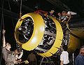Mounting motor on a Fairfax B-25 bomber, at North American Aviation, Inc., plant in Inglewood, Calif.jpg
