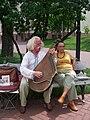 Musician on a park bench in Kiev, 2007.jpg