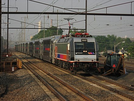 A NJ Transit train heads down the Northeast Corridor through Rahway, New Jersey NEC train 3967 passing through Rahway station, June 2007.jpg