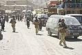 NZ Army soldiers patrolling through a town in Afghanistan.jpg