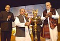 Narendra Singh Tomar lighting the lamp to inaugurate the National Conference of Sarpanches and Gram Panchayat Secretaries, in New Delhi.jpg
