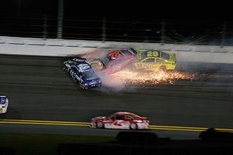 2016 Can-Am Duels - Jimmie Johnson, Matt Kenseth and Martin Truex Jr. on the final lap in turn 2