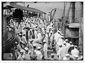 USS Washington (ACR-11) - Naval reserve sailors disembarking the USS Washington.