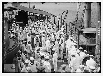 USS Washington (ACR-11) - Naval reserve sailors disembarking the USS Washington.