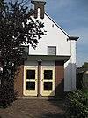 foto van Tweeklaviers kabinetorgel, met aangehangen pedaal en dertien registers in de Nederlands Gereformeerde Kerk