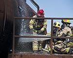 Nellis-Creech firefighters train with civilian counterparts 150327-F-JB386-310.jpg