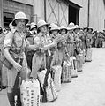 Newly-arrived British troops give the 'thumbs up' on the quayside at Singapore, November 1941. FE312.jpg
