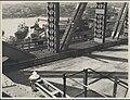 Newly laid roadway on the Sydney Harbour Bridge, 1932 (8283752016).jpg