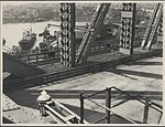 Newly laid roadway on the Sydney Harbour Bridge, 1932 (8283752016).jpg
