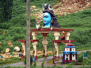 Nilakkal - Lord Shiva statue upon Nilakkal temple arch gate (2007 photograph)